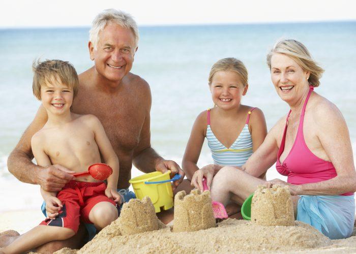 Shutterstock 279845435 Grandparents And Children On Beach